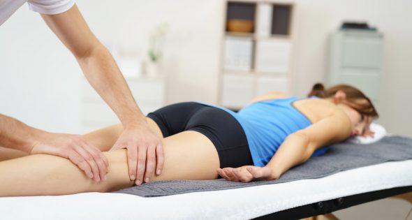 Sports massage on lady back of the leg