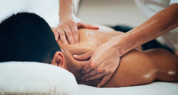 Sports massage on the man upper back