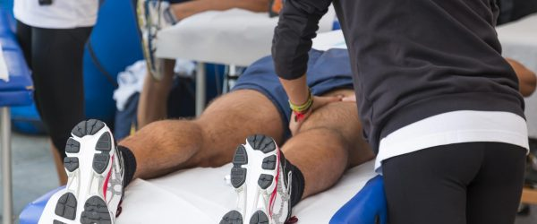 Sports massage on inside upper thigh