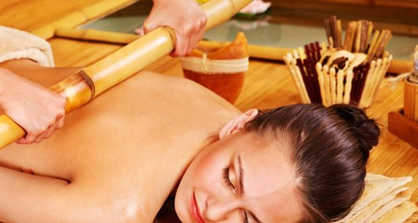 Young woman bamboo massage